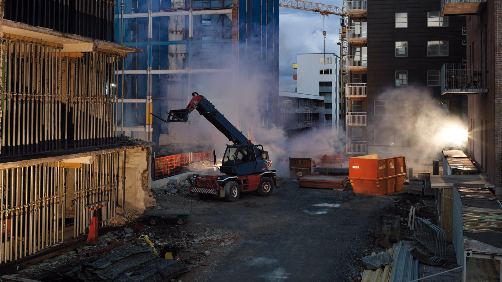 Heavy machine working near builidings.