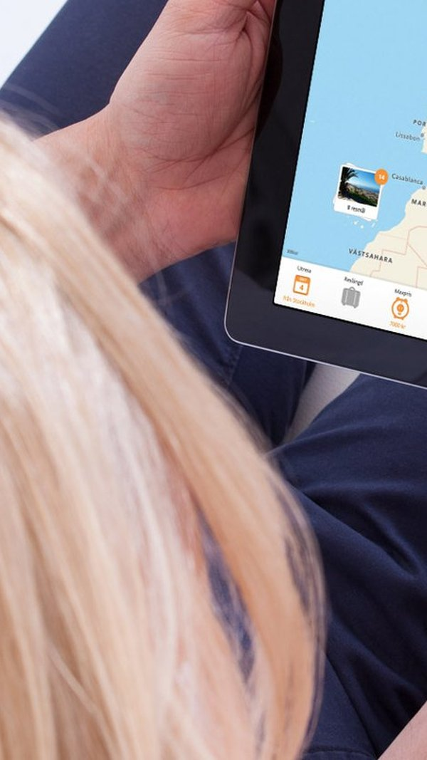 Persons looking at travel site on iPad.