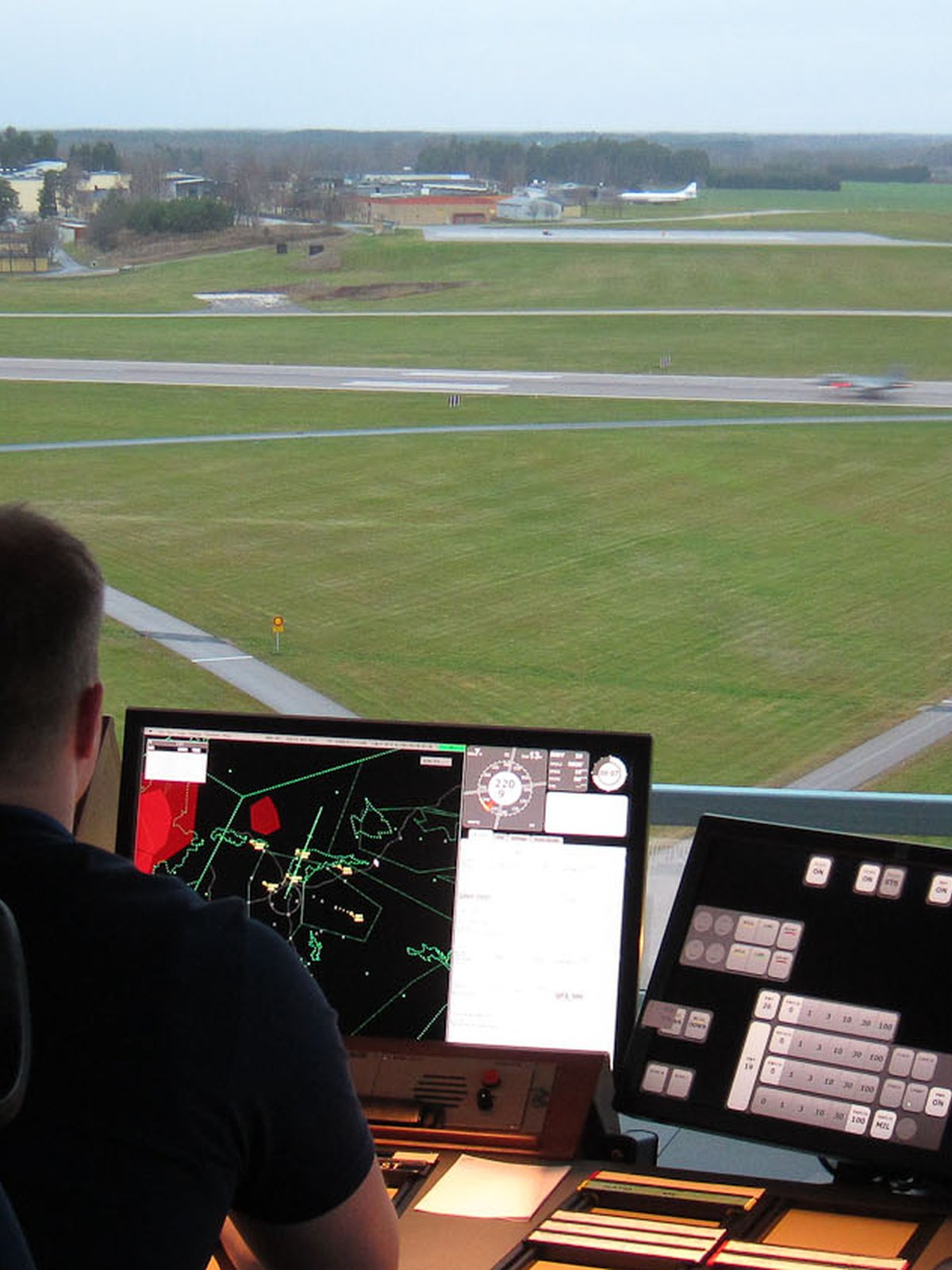 Person in flight control tower.