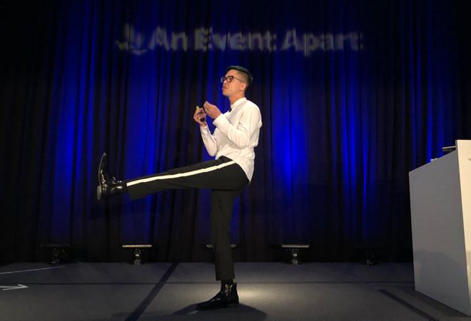 Michael Austin Sui on stage mid-kick