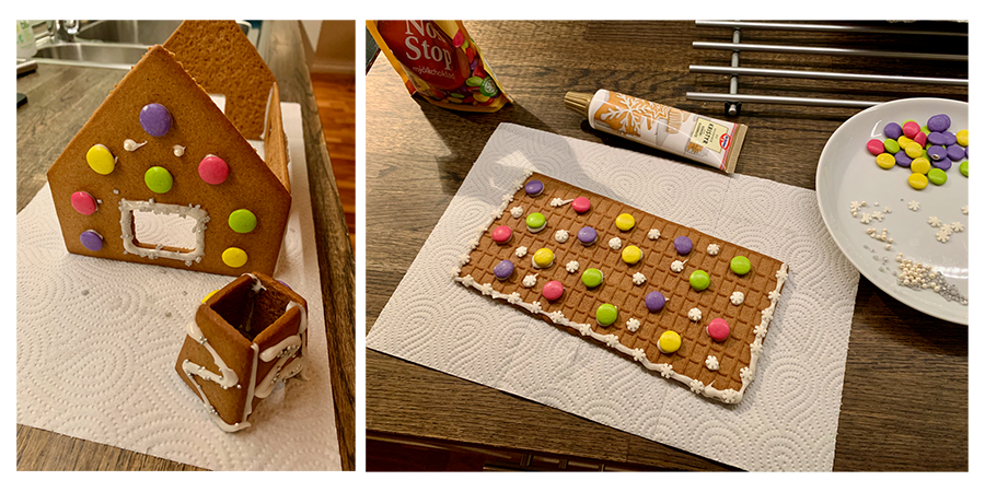 Parts of a gingerbread house in the making, gluing the parts together with frosting and decorating it with candy.